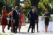 United States President Barack Obama, walks hand-in-hand with daughter Malia as he is followed by (L-R) first lady Michelle Obama, Harry Johnson, president and CEO of the MLK National Memorial Project Foundation, Andrea King carrying daughter Yolanda, and Michelle Obama's mother Marian Robinson (R) as they arrive for the dedication of the Martin Luther King, Jr Memorial on the National Mall in Washington DC USA, October 16, 2011.  The ceremony for the slain civil rights leader had been postponed earlier in the summer because of Tropical Storm Irene.   .Credit: Mike Theiler / Pool via CNP