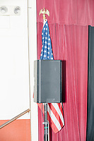 An American flag stands by the side of the stage as Democratic presidential candidate and Minnesota senator Amy Klobuchar speaks at a town hall campaign event at the Londonderry Senior Center in Londonderry, New Hampshire, on Wed., October 16, 2019. The event was part of a 10-county tour of New Hampshire and started the day after the 4th Democratic debate, in which analysts said Klobuchar performed well.