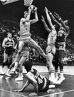 Oakland Oaks #42 Jim Eakins grabs rebound against Minnesota..ABA game in Oakland. (1969 photo/Ron Riesterer)