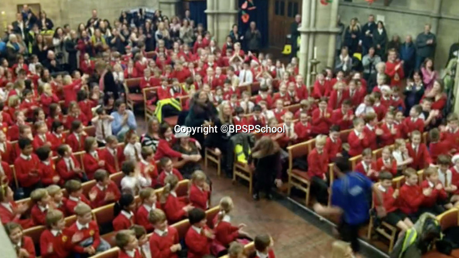 BNPS.co.uk (01202 558833)<br /> Pic: BPSPSchool/BNPS<br /> <br /> Excited children clapped along.<br /> <br /> Xmas cheer...<br /> <br /> A heartwarming performance from the hit movie Frozen has delighted primary school children in Poole Dorset - after teachers burst into song during a Xmas service in St Peters church in the town.<br /> <br /> Head teacher Paul Howieson led the staff in the impromptu performance, and even the vicar joined in as the children clapped along.<br /> <br /> Paul said 'The kids have all worked really hard through the year and we thought we would give them a Xmas service to remember.- they certainly seemed to enjoy it'.