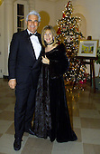 Barbra Streisand and her husband, James Brolin, arrive at the White House in Washington DC, Wednesday, December 20, 2000. Earlier in the day Steisand received a National Medal of Arts award from United States President Bill Clinton..Credit:  Mark Wilson / Pool via CNP