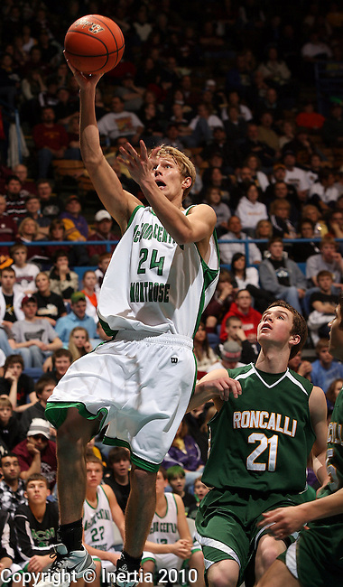 SIOUX FALLS, SD - MARCH 20: Mark Huls #24 of McCook Central/Montrose lays the ball up past Andrew Holmstrom #21 of Aberdeen Roncalli in the second half of their third place game Saturday night at the 2010 Boys Class A Basketball Championship at the Arena in Sioux Falls, SD. (Photo by Dave Eggen/Inertia)