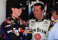 Feb 11, 2009; Daytona Beach, FL, USA; NASCAR Sprint Cup Series driver Denny Hamlin (left) talks with Robby Gordon during practice for the Daytona 500 at Daytona International Speedway. Mandatory Credit: Mark J. Rebilas-
