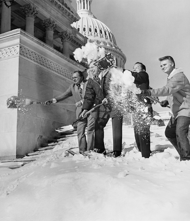 Sen. Spark Matsunaga, D-Hawaii removing snow with members at Capitol Hill in 1983. (Photo by CQ Roll Call)
