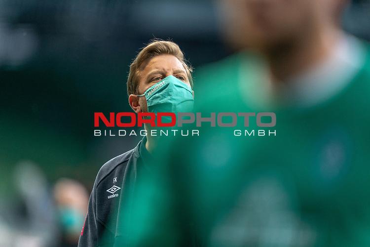 Florian Kohfeldt (Trainer SV Werder Bremen) mit CORONA Gesichtsmaske<br /> <br /> Sport: Fussball: 1. Bundesliga: Saison 19/20: <br /> 26. Spieltag: SV Werder Bremen vs Bayer 04 Leverkusen, 18.05.2020<br /> <br /> Foto ©  gumzmedia / Nordphoto / Andreas Gumz / POOL <br /> <br /> Nur für journalistische Zwecke! Only for editorial use!<br />  DFL regulations prohibit any use of photographs as image sequences and/or quasi-video.