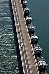 Nederland, Zeeland, Oosterschelde, 12-06-2009; Detail stormvloedkering met hydraulische cylinders voor de schuiven en zicht op de pijlers. Links de Oosterschelde, rechts de Noordzee, het water stroom met vloed onder de geopende kering door. .Close-up storm surge barrier in Oosterschelde (East Scheldt), hydraulic cylinders for the slides and sight on the pillars. Under normal circumstances the barrier is open to allow for the tide to enter and exit. In case of high tides in combination with storm, the slides are closed. North Sea with high tide on the right..Swart collectie, luchtfoto (25 procent toeslag); Swart Collection, aerial photo (additional fee required).foto Siebe Swart / photo Siebe Swart