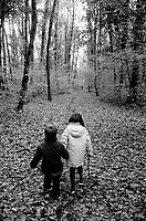 Switzerland. Canton Geneva. Chambésy. Nicola and Micaela Ruef, brother and sister, hold their hands and walk in the forest. Chambésy is 10 km distant from Geneva. MODEL RELEASED. © 2006 Didier Ruef