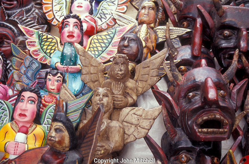 Wooden angel and devil sculptures from the state of Guerrero for sale in the market in Taxco, Mexico