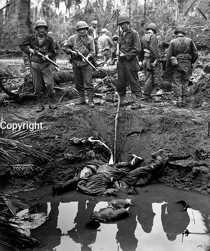 Three Jap snipers elected to shoot it out during the battle for Leyte Island.  Yankee bullets drilled the Nips and dropped them in a the muddy water of a bomb crater, where they sought shelter in a running rifle fight.  1944.  PhoM1c. Harry R. Watson.  (Coast Guard)<br /> Exact Date Shot Unknown<br /> NARA FILE #:  026-G-3558<br /> WAR & CONFLICT BOOK #:  1212