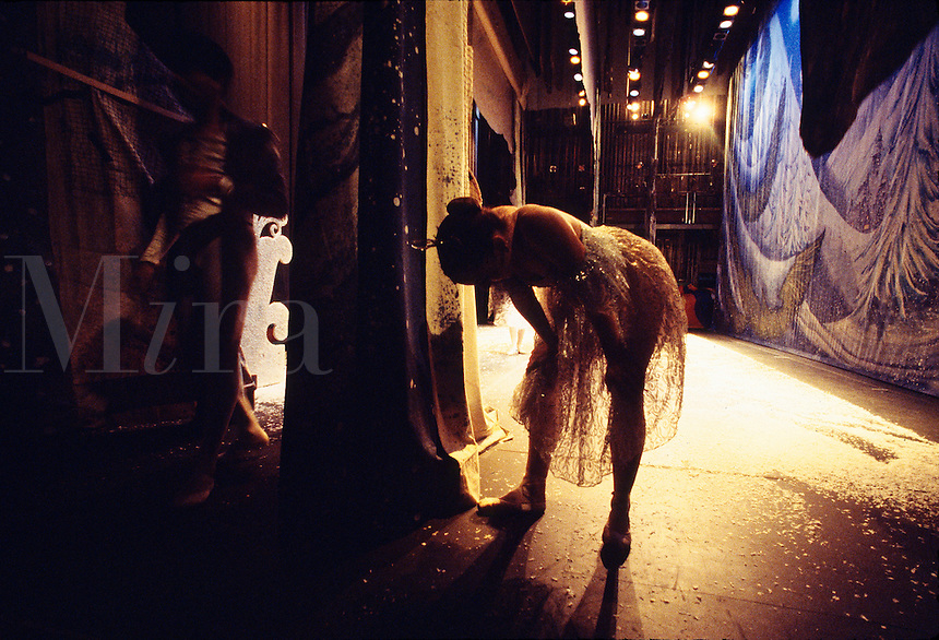 A ballet dancer catches her breath after performing on stage. Miami, Florida.