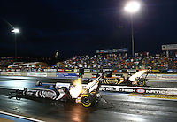 Jul. 19, 2013; Morrison, CO, USA: NHRA top fuel dragster driver Shawn Langdon (near lane) races alongside teammate Khalid Albalooshi during qualifying for the Mile High Nationals at Bandimere Speedway. Mandatory Credit: Mark J. Rebilas-