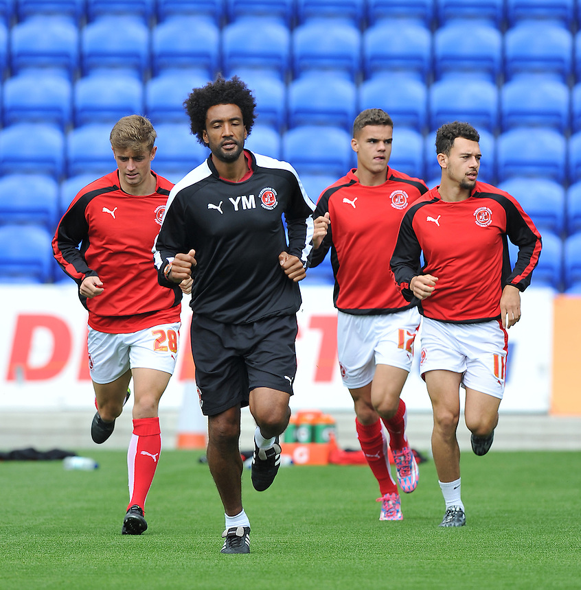 Fleetwood Town's Sports Scientist Youl Mawene leads the warm up<br /> <br /> Photographer Dave Howarth/CameraSport<br /> <br /> Football - The Football League Sky Bet League One - Oldham Athletic v Fleetwood Town - Saturday 15th August 2015 - SportsDirect.com Park - Oldham<br /> <br /> &copy; CameraSport - 43 Linden Ave. Countesthorpe. Leicester. England. LE8 5PG - Tel: +44 (0) 116 277 4147 - admin@camerasport.com - www.camerasport.com
