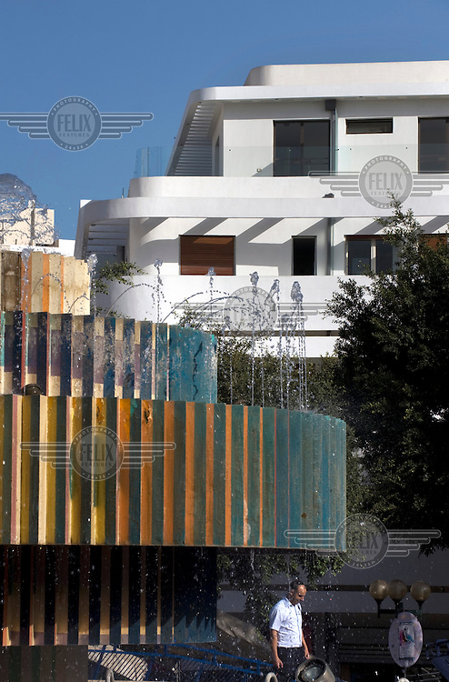 A Bauhaus style building behind the Fire and Water Fountain created by designer Yaacov Agam in Kikar Dizengoff Square. Tel Aviv is known as the White City in reference to its collection of 4,000 Bauhaus style buildings, the largest number in any city in the world. In 2003 the Bauhaus neighbourhoods of Tel Aviv were placed on the UNESCO World Heritage List. ..