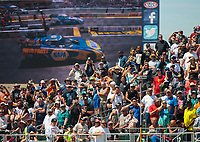 Jul 29, 2018; Sonoma, CA, USA; NHRA fans watch as funny car driver Ron Capps race John Force from the grandstands during the Sonoma Nationals at Sonoma Raceway. Mandatory Credit: Mark J. Rebilas-USA TODAY Sports