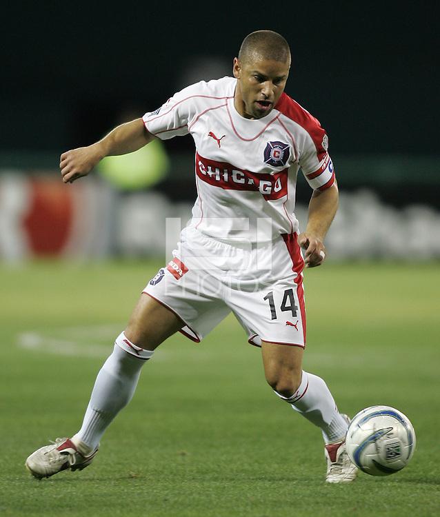 9 April 2005.   Chicago Fire midfielder Chris Armas (14) dribbles the ball upfield at RFK Stadium in Washington, DC.