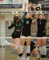 NWA Democrat-Gazette/ANDY SHUPE<br /> Van Buren's Zoe Morrison (left) sends the ball over the net Tuesday, Sept. 10, 2019, as Bentonville's Molly O'Dell (13) and Callie Neumann (1) defend during play in Tiger Arena in Bentonville. Visit nwadg.com/photos to see more photos from the match.