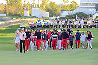 The U.S.A. team makes its way to the trophy presentation following round 4 Singles of the 2017 President's Cup, Liberty National Golf Club, Jersey City, New Jersey, USA. 10/1/2017. <br /> Picture: Golffile | Ken Murray<br /> <br /> All photo usage must carry mandatory copyright credit (&copy; Golffile | Ken Murray)