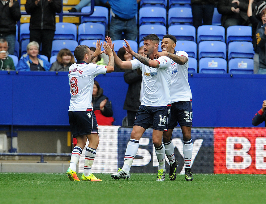 Bolton Wanderers's Gary Madine celebrates scoring his sides equalising goal to make the score 1-1 with team-mate Kaiyne Woolery and Jay Spearing<br /> <br /> Photographer Ian Cook/CameraSport<br /> <br /> Football - The EFL Sky Bet League One - Bolton Wanderers v Fleetwood Town - Saturday 20 August 2016 - Macron Stadium - Bolton<br /> <br /> World Copyright &copy; 2016 CameraSport. All rights reserved. 43 Linden Ave. Countesthorpe. Leicester. England. LE8 5PG - Tel: +44 (0) 116 277 4147 - admin@camerasport.com - www.camerasport.com