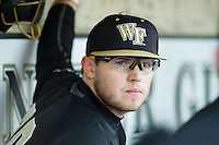 Jack Carey (20) of the Wake Forest Demon Deacons in the dugout during the game against the Georgetown Hoyas at Wake Forest Baseball Park on February 16, 2014 in Winston-Salem, North Carolina.  The Demon Deacons defeated the Hoyas 3-2.  (Brian Westerholt/Four Seam Images)