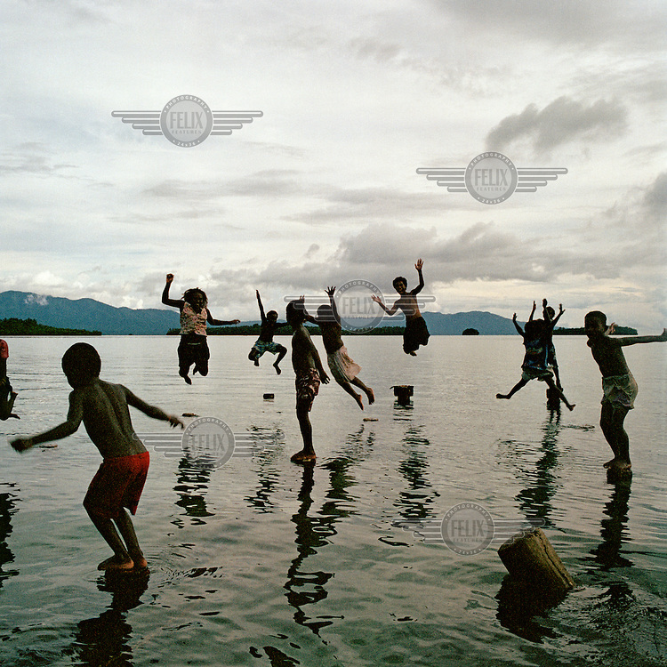 Children play in the Roviana Lagoon.