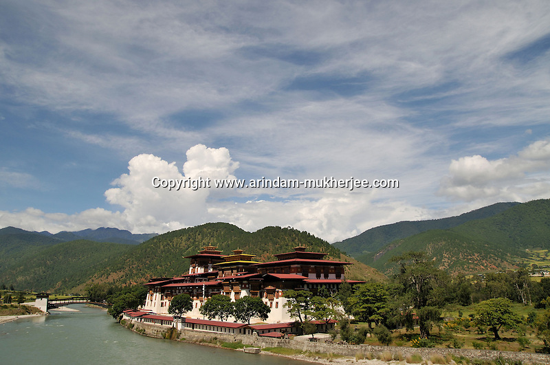 Punakha Dzong  or Pungtang Dechen Photrang Dzong is the administrative centre of Punakha dzongkhag, one of the 20 districts of Bhutan. Punakha was the capital of Bhutan and the seat of government until 1955, when the capital was moved to Thimphu. It is about 72 km away from Thimphu and it takes about 3 hours by car from the capital Thimphu. Unlike Thimphu it is quite warm in winter and hot in summer. It is located at an elevation of 1,200 metres above sea level and rice is grown as the main crop along the river valleys of two main rivers of Bhutan, the Pho Chu and Mo Chu. Dzongkha is widely spoken in this district..Arindam Mukherjee..
