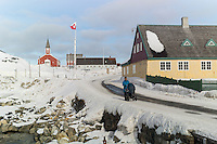 Nuuk, Greenland - A mother pushes a pram in Nuuk, Greenland, March 2016. Nuuk is the capital and largest city of Greenland. It is the seat of government and the country's largest cultural and economic centre. The major cities closest to the capital are Iqaluit and St. John's in Canada and Reykjavík in Iceland. Nuuk contains almost a quarter of Greenland's population, and also has the tallest building in Greenland. Nuuk is the seat of government for the Sermersooq municipality. In January 2016, it had a population of 17,316.