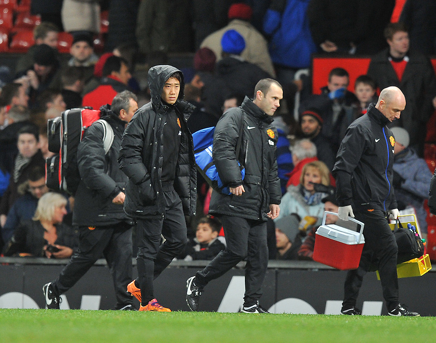 Manchester United's Shinji Kagawa walks of the pitch at the final whistle as an unused substitute<br /> <br /> Photo by Dave Howarth/CameraSport<br /> <br /> Football - Barclays Premiership - Manchester United v Fulham - Sunday 9th February 2014 - Old Trafford - Manchester<br /> <br /> &copy; CameraSport - 43 Linden Ave. Countesthorpe. Leicester. England. LE8 5PG - Tel: +44 (0) 116 277 4147 - admin@camerasport.com - www.camerasport.com