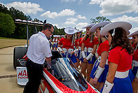 Apr 22, 2014; Kilgore, TX, USA; NHRA top fuel dragster driver Steve Torrence (left) explains the driving procedures during a race with the Kilgore College Rangerettes at the Torrence estate. Mandatory Credit: Mark J. Rebilas-USA TODAY Sports