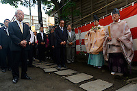 Ceremony at the Nawabari Shrine in Ishinomaki. The wall is marked by rescuers after the 2011 tsunami. Ishinomaki Kawabiraki Festival, Ishinomaki, Miyagi Prefecture, Japan, July 31, 2013. The Ishinomaki Kawabiraki Festival has been held annually since 1916 to honour Magobe Kawara an engineer who was instrumental in building the city's port and sea defences, as well as mourn those lost at sea. In recent years, the festival has commemorated the victims of the March 2011 earthquake and tsunami.