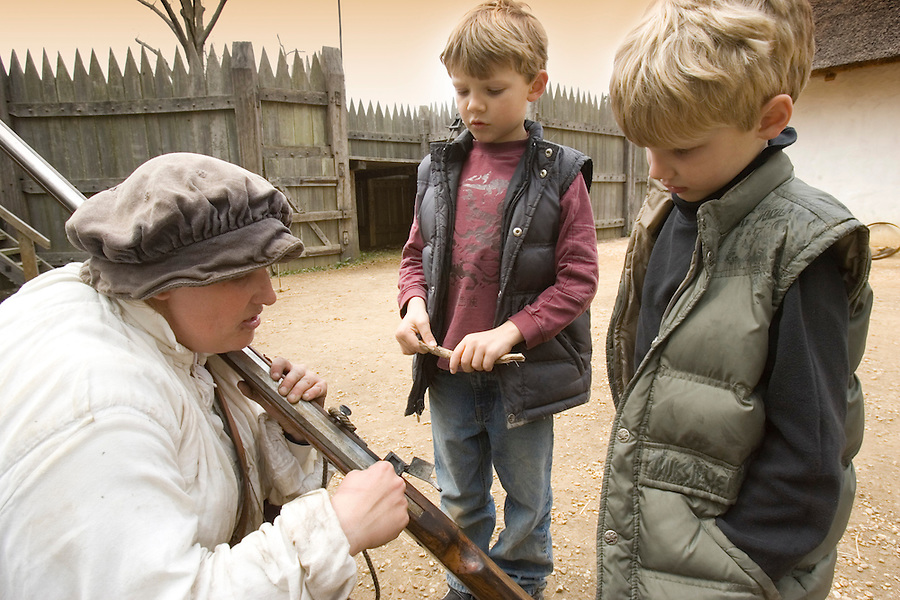 Slug: WK/Jamestown.Date: 04/14/2007.Photographer: Mark Finkenstaedt FTWP.Location: Jamestown Settlement..Caption: Brooke Pizzetti an interrupter at the Jamestown Fort recreation shows a matchlock musket to Davey (7) and Kurt (5) Finkenstaedt....© 2007 Mark Finkenstaedt. All Rights Reserved. Usual Post terms. LATimes WP News Service OUT unless under special arrangement with the photographer.