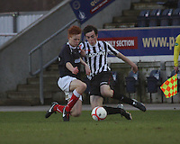 Sean Kelly lunges into the tackle with Scott Shepherd at the Falkirk v St Mirren  Scottish Football Association Youth Cup 4th Round match played at the Falkirk Stadium, Falkirk on 16.12.12.