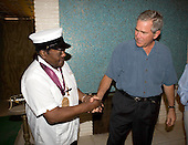 United States President George W. Bush shakes the hand of the legendary Fats Domino, wearing a National Medal of Arts, after the President presented it Tuesday, August 29, 2006, at the musician's home in the Lower 9th Ward of New Orleans.  The medal was a replacement medal for the one -- originally awarded by President Bill Clinton -- that was lost in the flood waters of Hurricane Katrina.  .Mandatory Credit: Eric Draper / White House via CNP