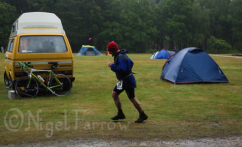 12 JUN 2011 - BRANSGORE, GBR - Enduroman competitor Bruce Laurence runs past the race campsite during the Enduroman Ultra Triathlon Championships (PHOTO (C) NIGEL FARROW)