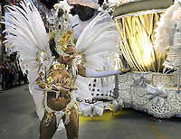 Dancer Nanda Guimaraes of Imperio da Tijuca samba school performs during parade at the Sambadrome, Rio de Janeiro, Brazil, March 2, 2014.  (Austral Foto/Renzo Gostoli)
