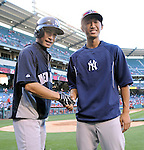 (L-R) Ichiro Suzuki (Yankees), Gosuke Kato,<br /> JUNE 14, 2013 - MLB :<br /> Ichiro Suzuki of the New York Yankees shakes hands with Yankees second round draft pick Gosuke Katoh during batting practice before the Major League Baseball game against the Los Angeles Angels at Anaheim Stadium in Anaheim, California, United States. (Photo by AFLO)