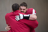 Hawgs Illustrated/BEN GOFF <br /> Bret Bielema, Arkansas head coach, hugs center Jake Raulerson during recognition of senior players before the game against Missouri Friday, Nov. 24, 2017, at Reynolds Razorback Stadium in Fayetteville.