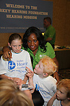 Sherri Sheppard with child who received a new hearing aid at the Starkey Hearing Foundation event on June 18, 2011 at the Las Vegas Hilton, Las Vegas, Nevada. (Photo by Sue Coflin/Max Photos)