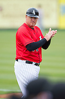 Kannapolis Intimidators manager Pete Rose Jr. (14) coaches third base during the South Atlantic League game against the Greenville Drive at CMC-Northeast Stadium on April 6, 2014 in Kannapolis, North Carolina.  The Intimidators defeated the Drive 8-5.  (Brian Westerholt/Four Seam Images)