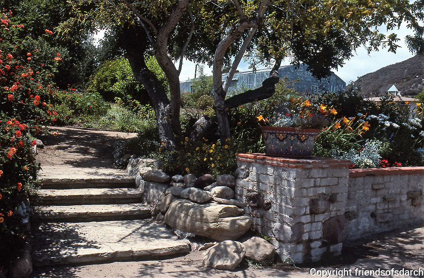 The Adamson House walkway with Spanish influence and lush landscaping. Situated near the Malibu Pier between popular Surfrider Beach and the Malibu Lagoon.It is now the Malibu Lagoon Museum. Photo--July 1989.