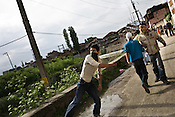 Kashmiri demonstrators raise anti-India slogans and clash with Indian police during an anti-election protest in downtown Srinagar, summer capital of Jammu and Kashmir, India. A 50 hour curfew was imposed on May 5th to boycott the elections on May 7, 2009. ..Kashmir went into polls on the 4th round of Indian general elections. About 26 percent polling was recorded in the Indian parliamentary elections held in Kashmir on Thursday, May 7th 2009. The poll percentage was on the higher side this year as compared to 2004 polls when 15.04 percent polling was recorded.