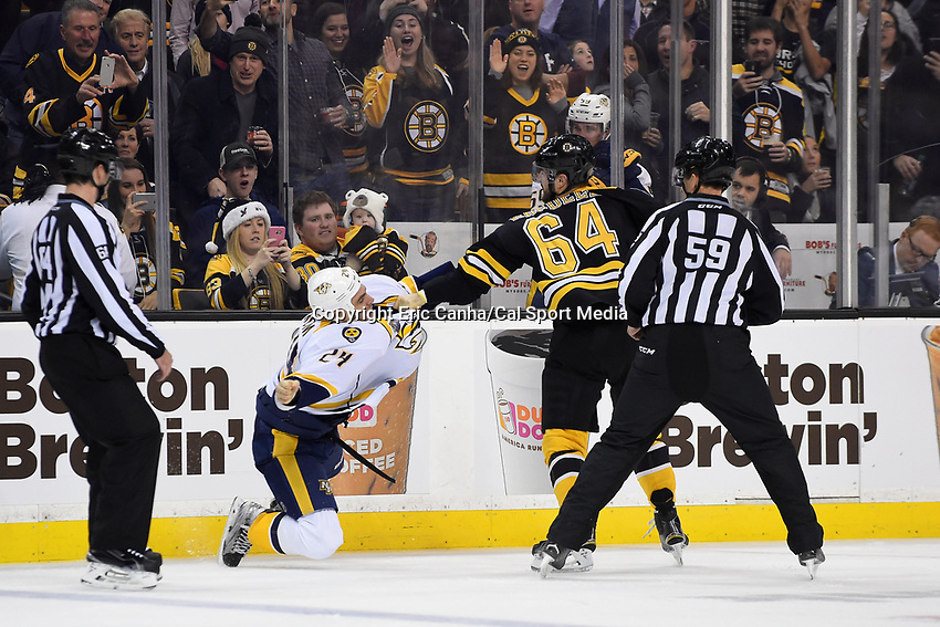 Monday, December 7, 2015: Boston Bruins right wing Tyler Randell (64) and Nashville Predators left wing Eric Nystrom (24) fight during the National Hockey League game between the Nashville Predators and the Boston Bruins held at TD Garden, in Boston, Massachusetts. The Predators defeat the Bruins 3-2 in regulation time. Eric Canha/CSM