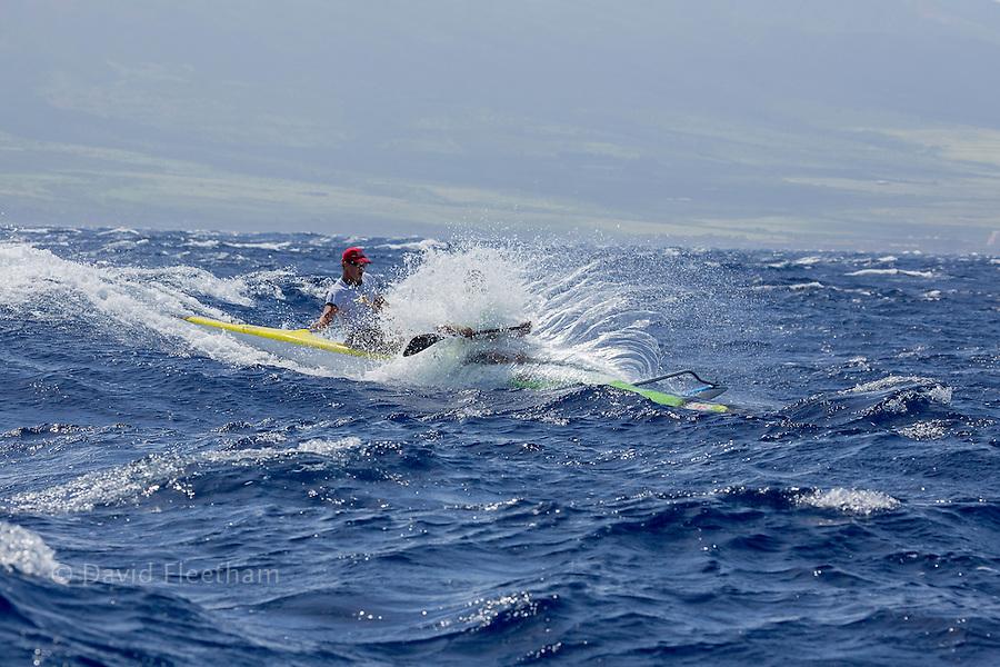 The two man paddle team of Mark Shimer and Bear Keahi (both MR) in the Maui Canoe and Kayak Club's 2014 Maui to Molokai race from DT Fleming Beach to Kaunakakai Harbor, Hawaii.
