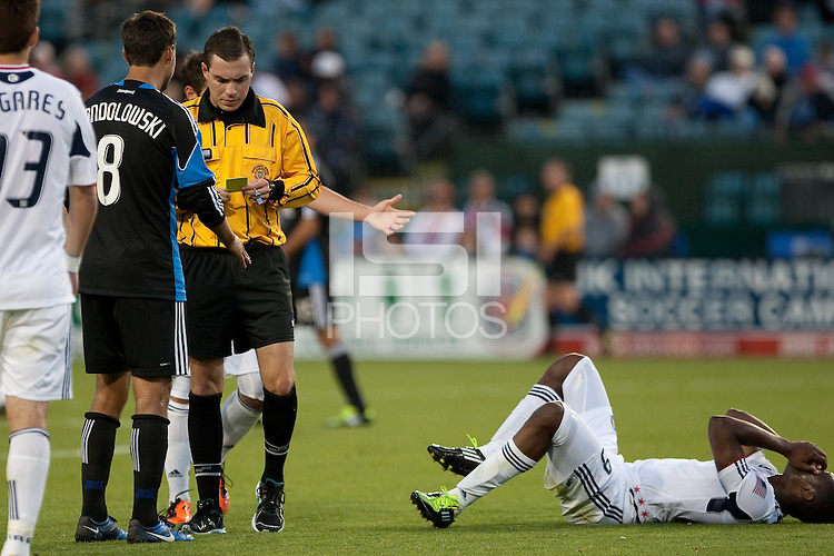 The referee issues a yellow card to San Jose.The Chicago Fire defeated the San Jose Earthquakes after going 5-4 on penalty kicks, after a 2-2 score in regulation during the US Open Cup at Buck Shaw Stadium in Santa Clara, California on May 24th, 2011.