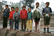 September, 1985. Shaanxi Province, China. Children of farmers in the area of Wuqi with photographer's self portrait.