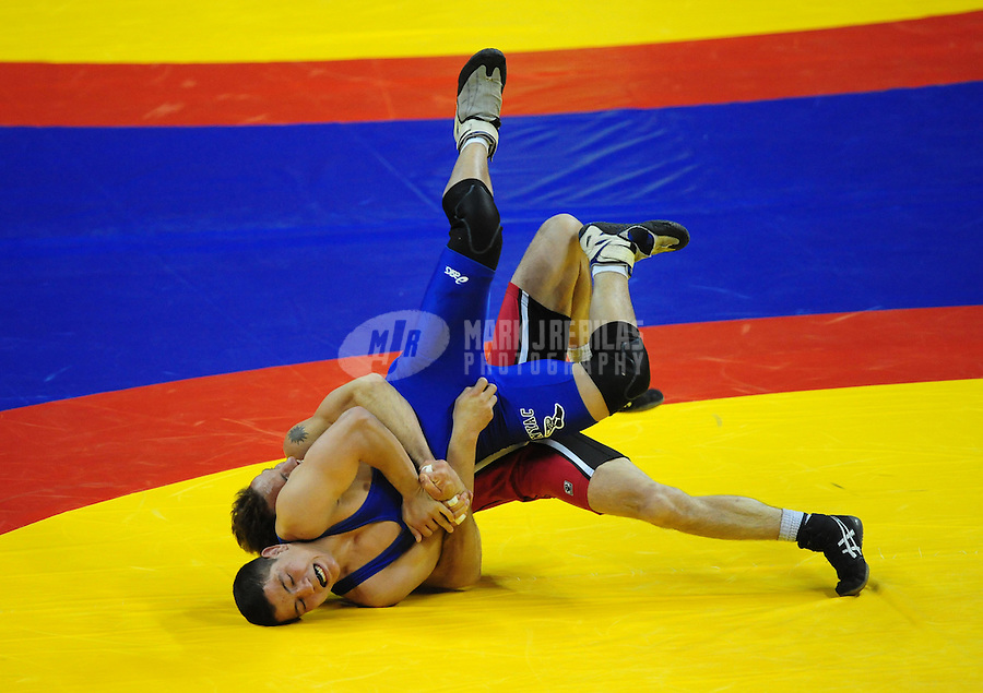 Jun 13, 2008; Las Vegas, NV, USA; Joe Betterman (blue) battles Glenn Garrison during the final in the 60kg class at the 2008 US Olympic Team Trials at the Thomas and Mack Center. Betterman won the competition. Mandatory Credit: Mark J. Rebilas-