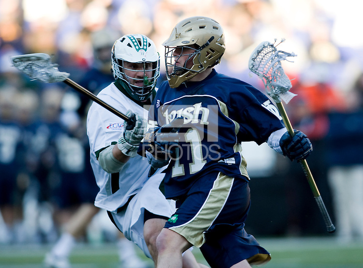 Steve Layne (2) of Loyola checks  Neal Hicks (11) of Notre Dame  as he moves towards goal during the Face-Off Classic in at M&T Stadium in Baltimore, MD