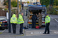 "Pictured: Police officer and a bomb disposal unit attend an incident in which a suspicious item has been discovered off Spencer Terrace in the Gurnos area of Cwmtwrch, Ystradgynlais in south Wales, UK.<br /> Re: ""Dyfed-Powys Police is currently dealing with a report of a suspicious item at Spencer Terrace, Lower Cwmtwrch. The item is described as a small box. Road closures are in place at Spencer Terrace and Heol Abraham, and a cordon is in place as a precaution. An Ordinance Disposal team is on their way and members of the public are asked to avoid the area so the incident can be dealt with safely. No further information is available."""