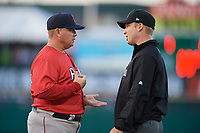 Pawtucket Red Sox manager Kevin Boles (19) argues with first base umpire Travis Godec during a game against the Rochester Red Wings on May 19, 2018 at Frontier Field in Rochester, New York.  Rochester defeated Pawtucket 2-1.  (Mike Janes/Four Seam Images)
