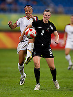 USWNT midfielder (16) Angela Hucles tries to kick the ball away from New Zealand defender (3) Anna Green while playing at Wulihe Stadium. The USWNT defeated New Zealand, 4-0, during the 2008 Beijing Olympics in Shenyang, China.  With the win, the USWNT won group G and advanced to the semifinals.