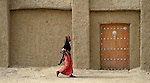 A woman walks in Timbuktu, a city in northern Mali which was seized by Islamist fighters in 2012 and then liberated by French and Malian soldiers in early 2013.
